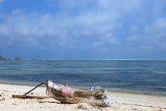 Single boat on tropical beach. Single boat on a tropical beach in Indonesia, Lombok, Kuta Stock Photo