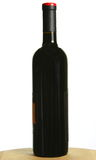 Single bottle of dark red wine Royalty Free Stock Images