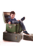 Single boy sitting in box looking to the camera Stock Image