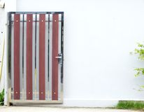 Single bright painted wooden door and white walls Stock Images