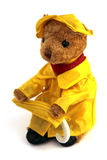 Single brown bear. In a raincoat and holding an umbrella Stock Photography
