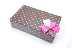 Single brown box with gifts and pink bow Stock Photo