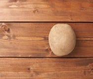 Single brown potato composition Royalty Free Stock Image