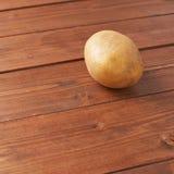 Single brown potato composition Royalty Free Stock Photos