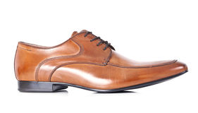 Single brown shoe. Single brown leather men shoe, on white background Royalty Free Stock Photos