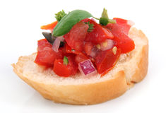 Single bruschetta. On bread over white background royalty free stock photo