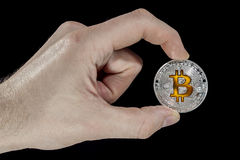 Single BTC Bitcoin coin in hand Royalty Free Stock Image