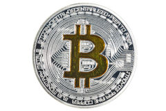 Single BTC Bitcoin coin. Shining silver and gold metal BTC bitcoin coin on white background stock image