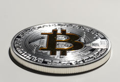 Single BTC Bitcoin coin. Shining silver and gold metal BTC bitcoin coin on white background royalty free stock photography