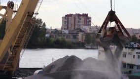 Single bucket dragline excavator unloading rubble. In a small river cargo port stock video footage
