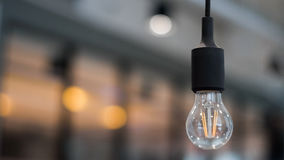 Single bulb in office building Stock Images