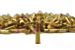 Single Bullet in Front of Hundreds Royalty Free Stock Image