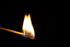Single burning match Royalty Free Stock Images