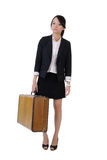 Single business girl holding old traveling case Royalty Free Stock Photography