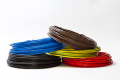 Single Cables in different colors. Single electric cables in blue, black, red, brwon and green-yellow Stock Images