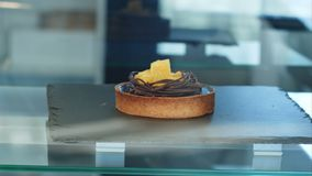 Single cake on a show-window of shop. Close up. Professional shot in 4K resolution. 091. You can use it e.g. in your commercial video, business, presentation stock footage