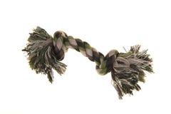Single camouflage colored dog toy bone rope Stock Photos