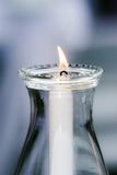 Single Candle. A burning candle in a glass case Royalty Free Stock Images