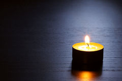 Single candle with back lit. Tranquil scene. Stock Photo