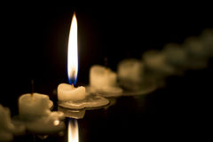 Single candle burning in the darkness Royalty Free Stock Images