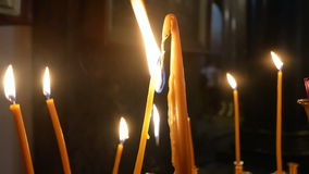 Candle church wax fire. Single candle with flame fire dripping wax in church cathedral stock video