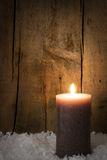 Single candle with snow Royalty Free Stock Photo
