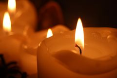Single candle up close stock photography