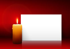 Single Candle with White Paper Panel on Red Background Royalty Free Stock Images