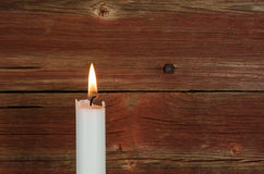 Single candlelight at old wall Royalty Free Stock Photos
