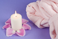 Single Candlelight and Pink Bathrobe Stock Photo