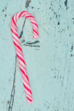 Single candy cane on a wooden background Royalty Free Stock Photos
