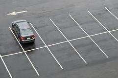 Single car in empty parking lot stock photography
