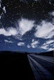 Single car travels on dark road. Under stars Royalty Free Stock Photo