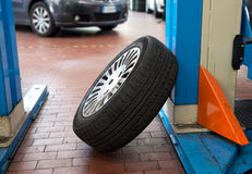 Single car tyre in a workshop Stock Photography