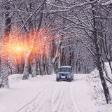 Single car on a winter road in the forest Royalty Free Stock Image