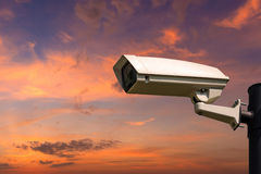 Single CCTV Security camera on beautiful sunrise sky Royalty Free Stock Images