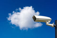 Single CCTV Security camera on blue sky Royalty Free Stock Photo