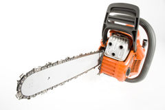 Single chainsaw. A very nice orange chain saw in the studio royalty free stock photos