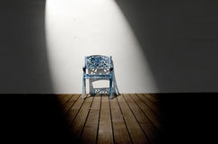 Single chair in empty room Stock Images
