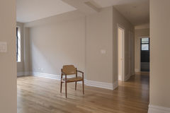 Single chair in empty room Stock Photo