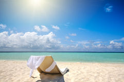 Single chair on the white sand beach. Vacation concept Royalty Free Stock Photos