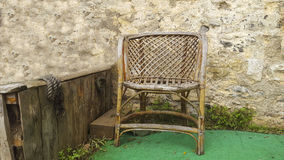 Single Chair. Wooden chair in front of wall Royalty Free Stock Photos