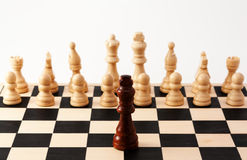 Single chess piece standing against or leading Stock Photo
