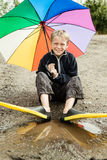 Single child in diving flippers and umbrella Stock Photo