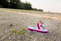 Single child flipflop on empty beach Royalty Free Stock Photography