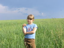 Single child under dark storm sky Stock Photography