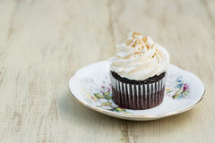 Single Chocolate Cupcake With Whipped Vanilla Frosting On Plate Royalty Free Stock Image