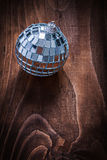 Single christmas hanging toy mirror disco ball on old wooden boa Royalty Free Stock Photos