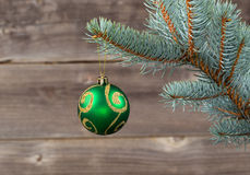 Single Christmas Ornament hanging from Blue Spruce Branch. Horizontal image of single Christmas ornament hanging from real Blue Spruce tree branch with rustic Royalty Free Stock Image
