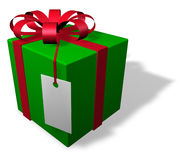 Single christmas package with tag. Single wrapped christmas packages in red and green with a tag Stock Images